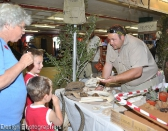 Shamwari's Game Ranger interacting with young visitors at their stand